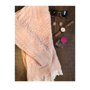 Light pink cable knit sweater with lace.